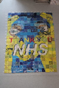 painted wall tiles celebrating the work of the NHS