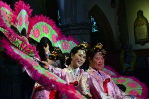 Korean dancers in traditional dress smiling