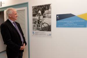 Friend of Roy Dominy looking at the plaque at the opening of the Acute Referral Centre
